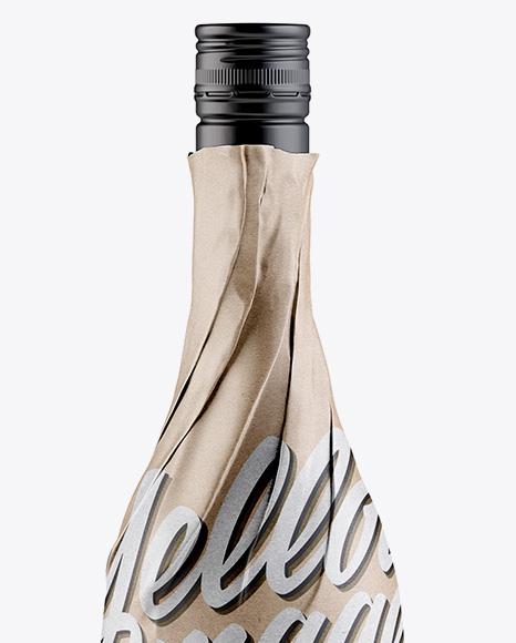 wine bottle in kraft paper wrap w   label mockup in bottle